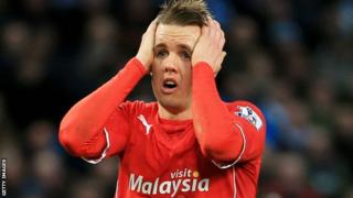 Cardiff City winger Craig Noone holds his head in his hands