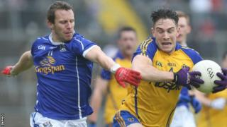 Cavan's Micheal Lyng and Roscommon's Neil Collins