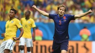 Daley Blind celebrates after scoring for the Netherlands against Brazil