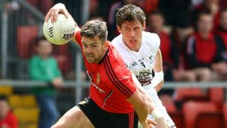 Down's Conor Laverty in possession against Emmet Bolton of Kildare in the All-Ireland qualifier at Pairc Esler