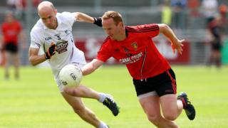 Hugh McGrillen of Kildare tries to close down Down dangerman Benny Coulter
