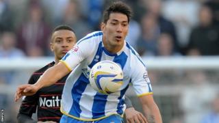 Brighton & Hove Albion's Leonardo Ulloa chests the ball under pressure from Reading's Michael Hector