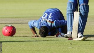 Afghanistan's Dawlat Zadran bows his head after his match-winning innings