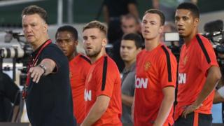 Manchester United manager Louis Van Gaal with players Antonio Valencia, Luke Shaw, Jonny Evans and Chris Smalling during the club's pre-season tour in America