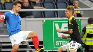 Linfield's Matthew Clarke in action against AIK Solna in the Europa League
