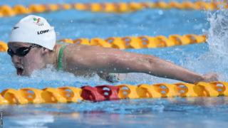 Jemma Lowe competes in the women's 100m butterfly on the first day of the Commonwealth Games.
