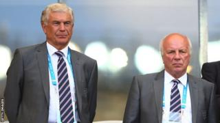 Director of Football Development in England Sir Trevor Brooking (L) and Chairman of the FA Greg Dyke look on during the 2014 FIFA World Cup Brazil Group D match between Costa Rica and England at Estadio Mineirao on June 24, 2014.