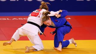 Audree Francis-Methot of Canada competes with Lisa Kearney of Northern Ireland during the -52kg bronze medal judo contest