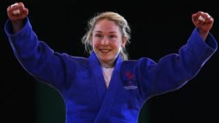 Northern Ireland's Lisa Kearney celebrates the victory over Audree Francis-Methot which earned her a bronze medal at the 2014 Commonwealth Games