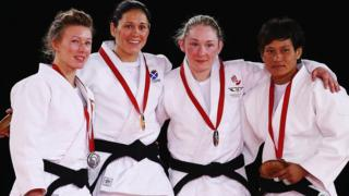 Silver medallist Kelly Edwards of England, champion Louise Renicks of Scotland with bronze medal winners Lisa Kearney of Northern Ireland and Kalpana Thoudam of India on the podium