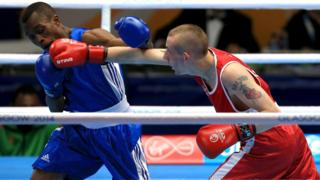 "Northern Ireland's Ruairi Dalton on the offensive against Zambia""s Christopher Katanga in a flyweight bout"