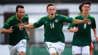 Mikhail Kennedy celebrates scoring against China in the MIlk Cup Elite section