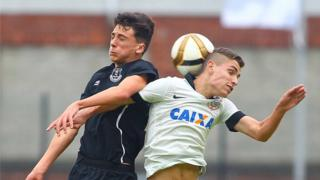 Everton's Fraser Hornby and Felipe Oliveira of Corinthians in aerial combat during their Junior match