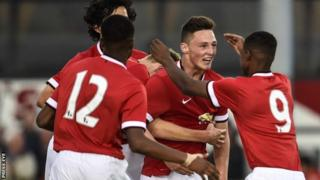 Jordan Andrew Thompson is congratulated by Man Utd team-mates