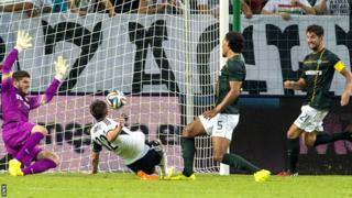 Legia Warsaw's Miroslav Radovic scores against Celtic