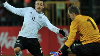 Michal Szromnik (right) has joined Dundee United on a three-year contract