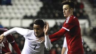 Wales' Tom Lawrence (R) challenges England's Tom Ince during during an Under-21 European Championship qualifier at Pride Park