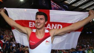 England's Steve Lewis celebrates his pole vault gold medal