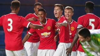 Manchester United celebrate the goal which gave them victory in the Premier Section at the 2014 Milk Cup