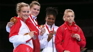 Middleweight Lauren Price (right) made history as the first Welsh female boxer to win a medal at the Commonwealth Games, securing bronze.