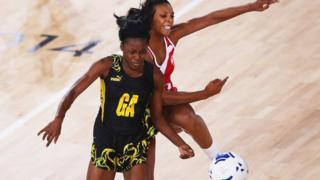 Jamaica and England netball players compete for the ball at the 2014 Commonwealth Games in Glasgow