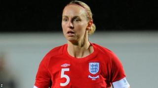 Former England captain Faye White in action