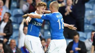 Kenny Miller congratulates the scorer of Rangers' first goal, Lewis Macleod