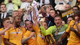 Cambridge United celebrate winning promotion from the Conference