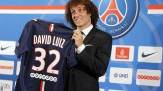 David Luiz holds up PSG jersey