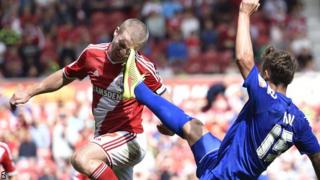 Middlesbrough's Grant Leadbitter and Birmingham's Grant Hill challenge for the ball