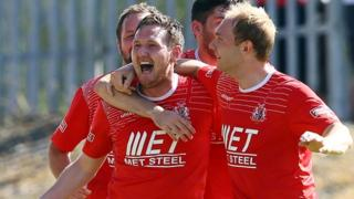 Gary Twigg celebrates scoring against Linfield