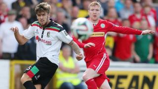 Glentoran's Stephen McCullough in action against Chris Curran of Cliftonville during the 0-0 draw at Solitude