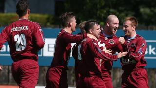 Institute celebrate a goal by Stephen O'Flynn as they marked their return to the Irish League's top flight with a 2-2 draw away to Dungannon Swifts