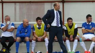 Warren Feeney endured a disappointing first league match as Linfield manager as last season's Premiership runners-up crashed to a 3-0 defeat at Portadown