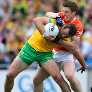 Armagh defender Charlie Vernon gets to grips with Donegal forward Michael Murphy
