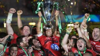 Toulon's Jonny Wilkinson lifts the trophy after winning the Heineken Cup
