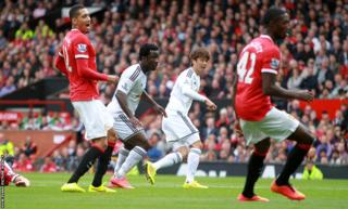 Ki Sung-yueng scores to give Swansea City a first half lead at Old Trafford against Manchester United.