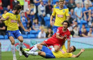 Cardiff full-back Fabio Da Silva is tackled by Huddersfield's Jonathan Hogg during the Championship game at Cardiff City Stadium.