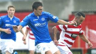 Hamilton's Dougie Imrie breaks clear from Adam Morgan