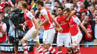 Aaron Ramsey celebrates with team-mates after his late goal secured Arsenal a 2-1 win over managerless Crystal Palace.