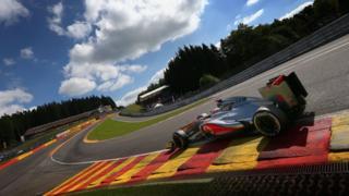 McLaren's Jenson Button drives through Eau Rouge