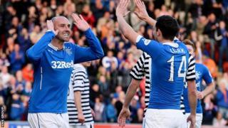 Kris Boyd (left) celebrates his opener with Rangers team-mate Nicky Clark