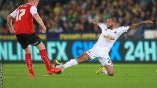 Ashley Richards of Swansea City tackles Conor Newton of Rotherham United