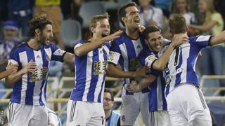 The Real Sociedad players celebrate a David Zurutuza goal