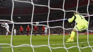 Wayne Rooney scores from the penalty spot for England