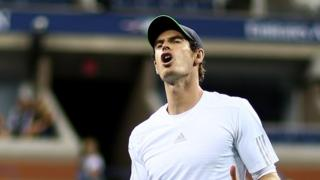 Andy Murray reacts to losing in the quarter-final of the US Open