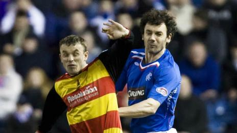 Mark Roberts (left) is out jumped by Rangers defender Christian Dailly