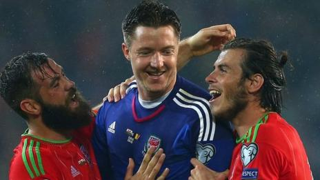 Joe Ledley, Wayne Hennessey and Gareth Bale celebrate