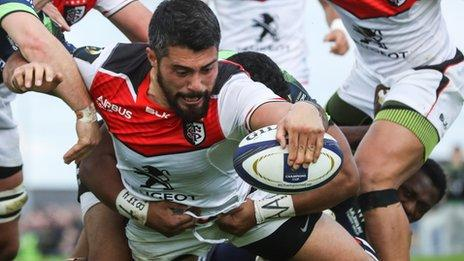 Toulouse's Yann David scores a try before half time