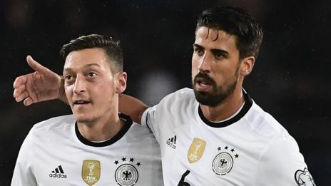 Mesut Ozil and Sami Khedira of Germany